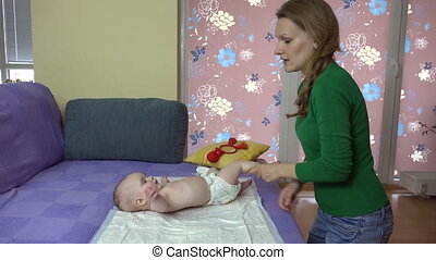 mom with baby exercise - young mother make exercise with...