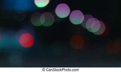 Bokeh Traffic Lights - Traffic passing by the camera. The...
