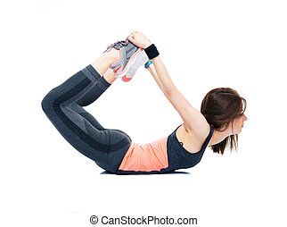 Woman doing stretching exercises on the floor