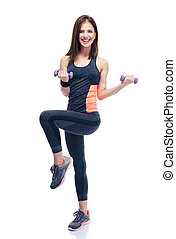 Smiling woman working out with dumbbells - Full length...