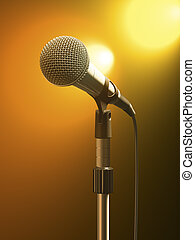 Microphone on stand with orange stage lights.
