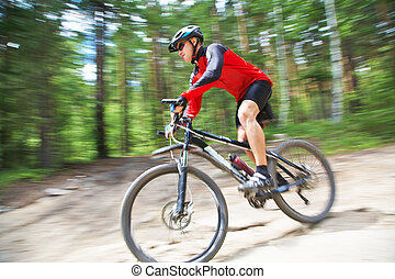 male riding a mountain bike - young male riding a mountain...