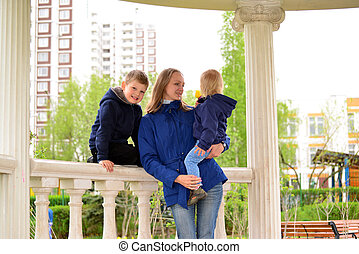 Mother with two children on  walk