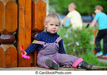 Two year old girl on park bench - Two year old girl on a...