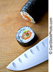 Maki and Japanese knife in the kitchen of a restaurant