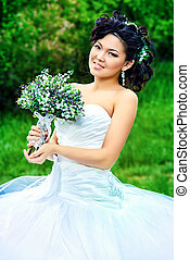 chinese - Beautiful elegant asian bride in a summer park...