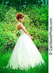 fiancee - Lovely elegant red-haired bride stands on the...