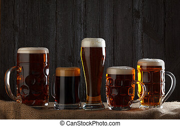 Beer glasses with lager, dark lager, brown ale, malt and...