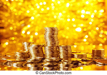 Golden goins stack with golden lights bokeh background