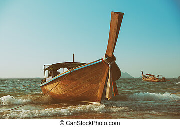 Traditional longtail wooden boat at Andaman sea, retro toned