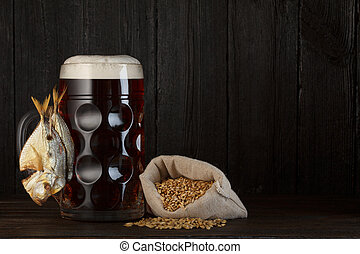 Beer mug with smoked salty fish