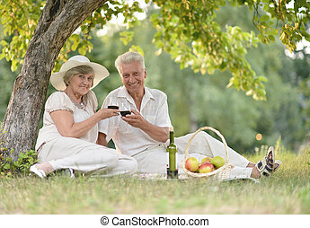 loving elderly couple spending time together outdoors