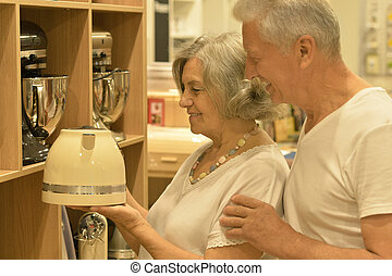 senior couple in a shopping center - Beautiful senior couple...