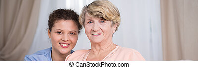 Portrait of nurse and patient - Portrait of young smiling...