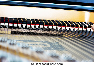 Inside of a piano mechanism - Piano mechanism looking from...