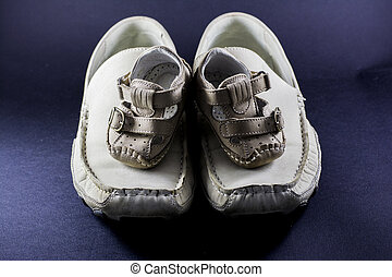 Father and son shoes isolated on black background