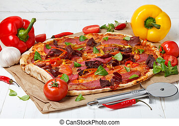Hot pizza with ingredients