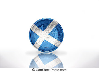 euro coin with scottish flag on the white background