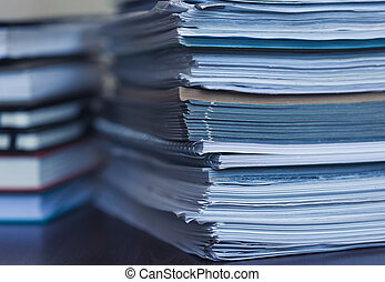 Accounting and taxes. Large pile of magazine and books...