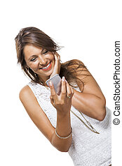 Vivacious woman reacting to a text message - Vivacious...