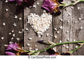 heart shape of white lilac flowers on wood table - heart...