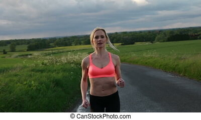Young lady running on a rural road