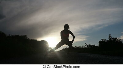 Woman Stretching In The Sunset