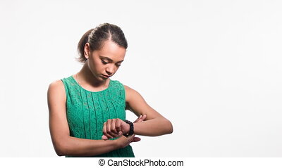 young black woman looking at her watch and experiencing