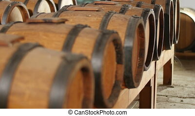 balsamic vinegar barrels - dolly shot of balsamic vinegar...