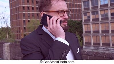 Handsome businessman wearing glasses speaking using his...