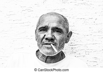 Portrait of an older man smoking - Older hardworking man...