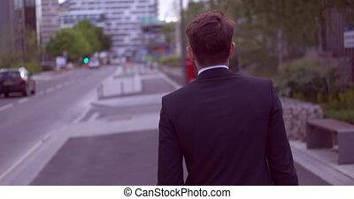 Handsome businessman walking along