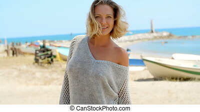 Woman in Grey Sweater on Beach with Fishing Boats - Waist Up...