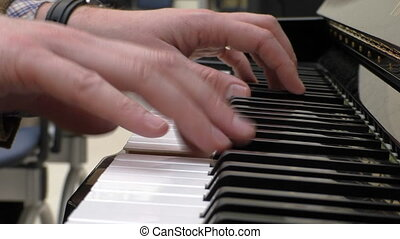 Pianist hands closeup - Close up of hands of a man playing...