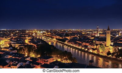 verona skyline at night pan - verona cityscape a night pan...