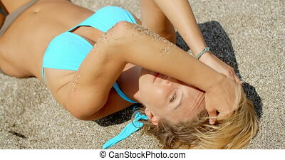 Woman Shielding Eyes from Sun with Arm on Beach - Smiling...