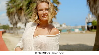 Blond Woman at Beach Gazing at Camera - Waist Up Portrait of...