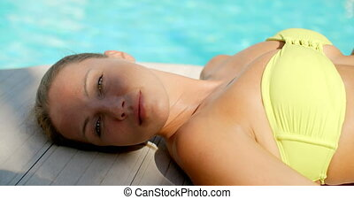 Close Up of Woman Lying Next to Swimming Pool - Close Up of...