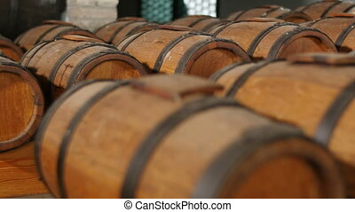 wine barrels pan in wine cellar - wine casks in row stacked...