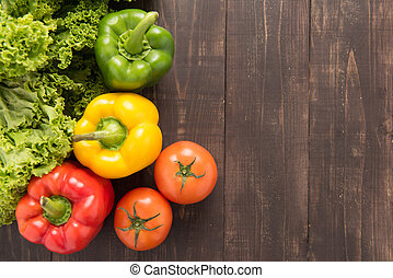 Vegetables on wooden backgorund, Organic food background. -...