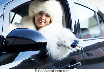 Smiling woman with car key