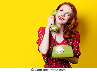 girl in red dress with green dial phone - Smiling redhead...