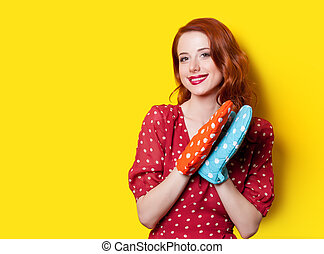 girl in red dress with mittens - Smiling redhead girl in red...