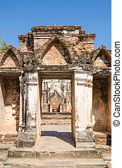 ancient front gate in ancient temple at Sukhothai historical...