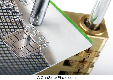 close up of credit card and padlock - secure payment concept