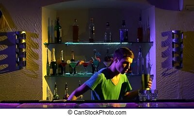 Professional bartender making cool tricks with two glasses,...