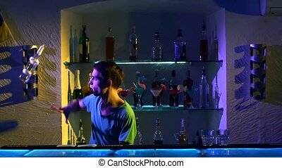 Professional bartender making cool, amazing tricks using two...