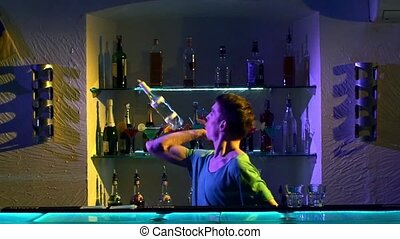 Professional bartender making cool, amazing tricks using...