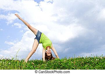 Young girl doing cartwheel - Young teenage girl doing...