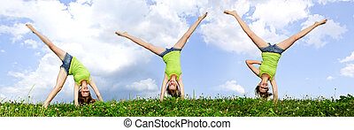 Young girl doing cartwheel - Composite image of young...